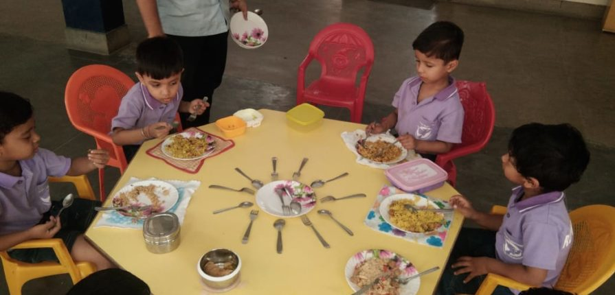 Children learning Table Manners